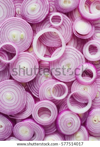 Red Onion Slices. Sliced red onion rings. Royalty-Free Stock Photo #577514017