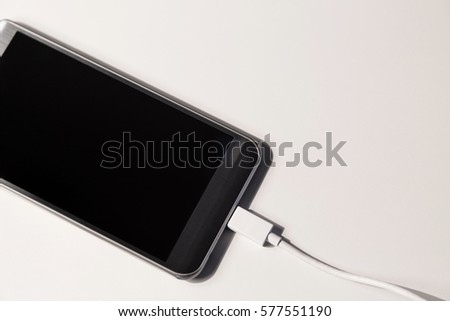 Smart phone charging, isolated on a white surface #577551190