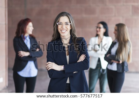 Successful woman leading a business group and looking happy #577677517