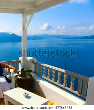 View to the sea from Oia village of Santorini island in Greece #577863238