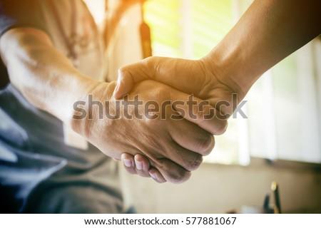 Business partnership meeting concept. Image businessman handshake. Successful businessmen handshaking after good deal. Horizontal, blurred background Royalty-Free Stock Photo #577881067