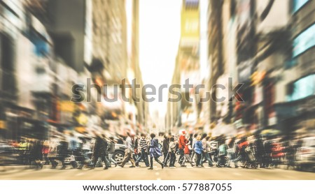 People walking on zebra crossing on 7th avenue in Manhattan - Crowded streets of New York City during rush hour in urban business area - Retro desaurated contrast filter with soft sharpness and focus Royalty-Free Stock Photo #577887055