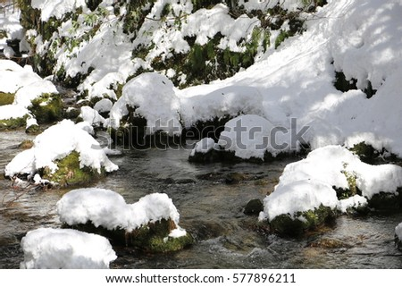 A snow-covered river #577896211