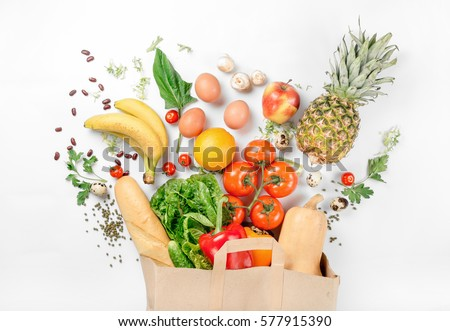 Paper bag of different health food on a white background. Top view. Flat lay #577915390