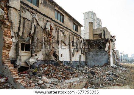 Interior of old factory buildings destroyed. Ruins of industrial enterprise, dark debris destroyed factory premises in factory as result of economic crisis and earthquake. #577955935