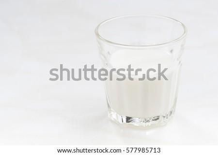glass of milk on a white background, closeup, horizontal #577985713