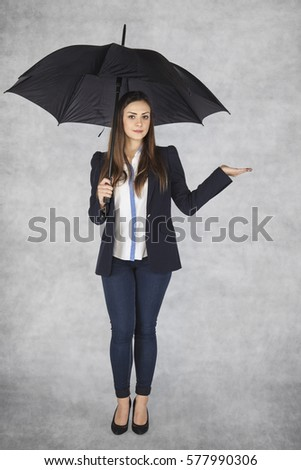 business woman under umbrella, copy space above hand #577990306