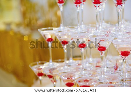 Catering table still life with a pyramid of champagne glasses  #578165431