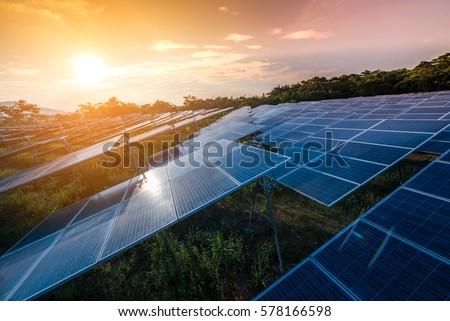 Beautiful sunset over Solar Farm Royalty-Free Stock Photo #578166598
