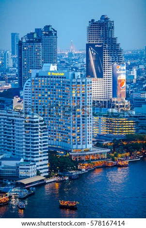BANGKOK, THAILAND - JAN 3, 2017: A Night scene of Bangkok Cityscape with Chao Phraya River in Bangkok metropolis Thailand. #578167414