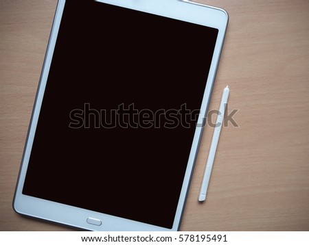 Digital tablet with blank screen on wood work desk, soft focus, business and education technology background #578195491