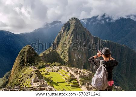 Tourist Takes Photo of Machu Picchu Lost City of Inca, Peru
