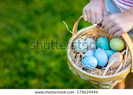 Close up of colorful Easter eggs in a basket Royalty-Free Stock Photo #578624446