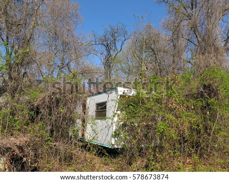 Rusted old trailer, abandoned in the woods.                                #578673874
