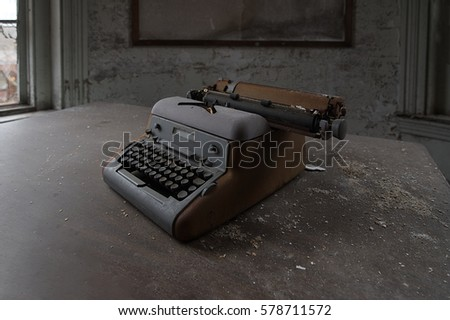An Antique Typewriter in an Abandoned Hospital #578711572