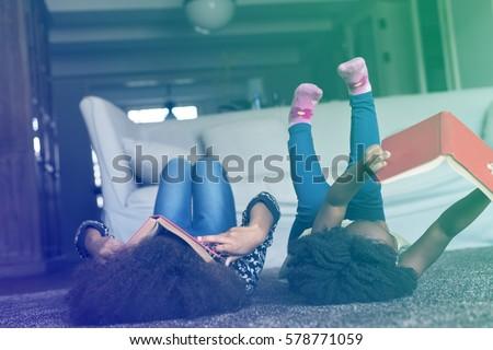 Little Girls Lay On The Floor Reading Book Sisterhood #578771059