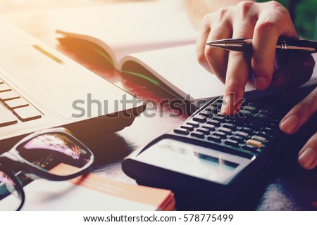Close up woman doing finance at home office with calculate expenses Royalty-Free Stock Photo #578775499