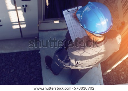 engineer or electrician working on checking status step up transformer high voltage on transformer yard and solution problem to operate at green energy solar power plant  #578810902