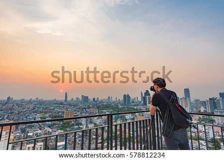 BANGKOK, THAILAND - FEBRUARY 9, 2017 : A photographer is taking the pictures of west view of Bangkok during sunset. #578812234