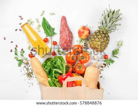 Full paper bag of healthy food on a white background. Top view. Flat lay #578848876