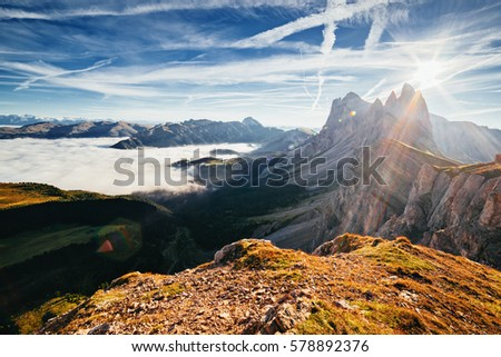 Aerial view of the alpine valley in sunlight. Great and gorgeous morning scene. Location place Puez-Odle National Park, Gardena, Seceda peak, Geisler Dolomiti group. Tyrol, Italy, Europe. Beauty world #578892376