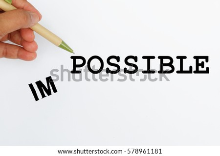 I and M falling to the left side leaving the word POSSIBLE, changing Impossible to Possible. Concept of possibility, confidence, positive, determination.  #578961181