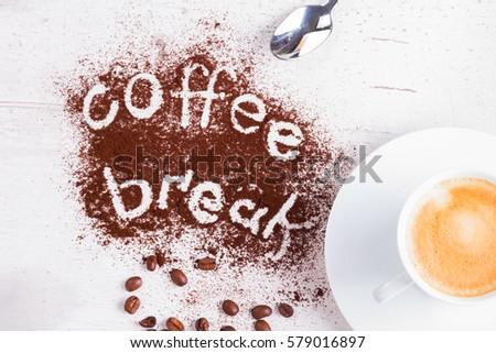 coffee break concept - cup of espresso and coffee break lettering #579016897