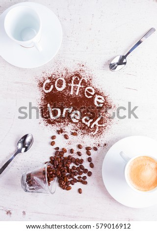 coffee break concept - empty cup and cup of espresso with coffee break lettering #579016912