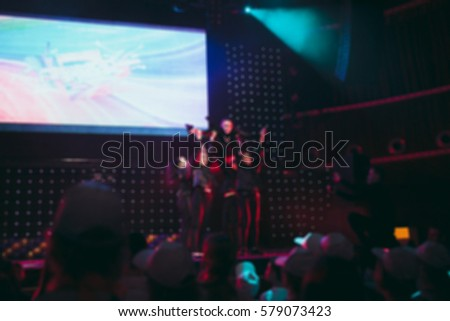 Blurred background : Bokeh lighting in concert with audience, Music showbiz concept #579073423