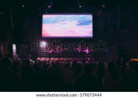 Blurred background : Bokeh lighting in concert with audience, Music showbiz concept #579073444