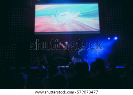 Blurred background : Bokeh lighting in concert with audience, Music showbiz concept #579073477
