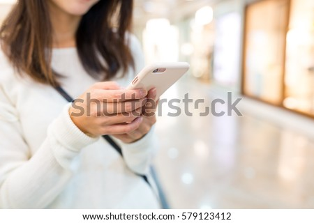 Woman typing text message on cellphone #579123412