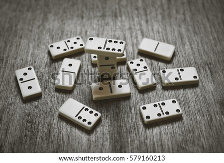 domino pieces on the brown wooden table background #579160213