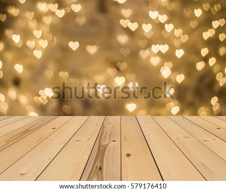 wood floor and yellow gold heart bokeh background , Love Valentine day concept