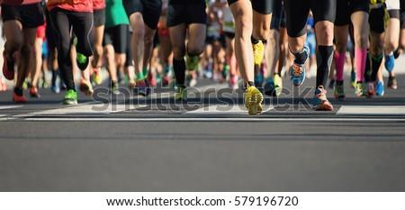Marathon running in the light of evening #579196720