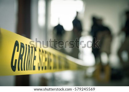 crime scene tape with blurred forensic law enforcement background in cinematic tone and copy space Royalty-Free Stock Photo #579245569