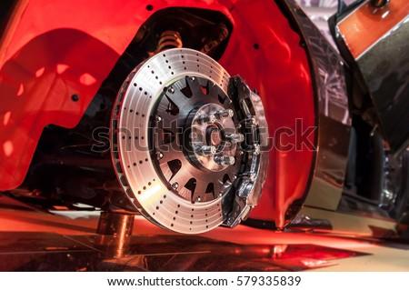 Brake disk and detail of a wheel hub Royalty-Free Stock Photo #579335839