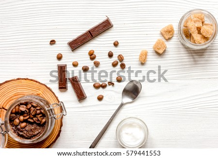 Organic cosmetics based on coffee top view wooden background #579441553