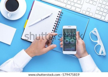 Man holding tablet in hand. Digital technology. Innovative implementation in business. Internet applications. Tablet phone and camera. Developing applications on the Internet. Flat lay photo