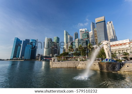 SINGAPORE - MARCH 1, 2015: Sunrise scene of Singapore skyline with merlion on march 1, 2015. Merlion fountain is one of the most famous tourist attraction in Singapore. #579510232