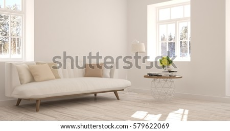 White room with sofa and winter landscape in window. Scandinavian interior design. 3D illustration #579622069