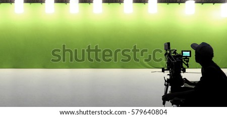 Camera and green screen studio in panorama view and man working or shooting or recording or filming.