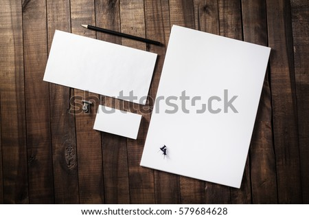 Photo of blank corporate identity. Stationery set. Branding mockup. Sheets of paper, letterhead, business cards, envelope and pencil. Royalty-Free Stock Photo #579684628
