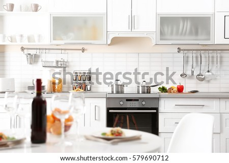 Modern kitchen interior with served table #579690712