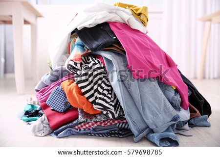 Messy colorful clothing, closeup Royalty-Free Stock Photo #579698785
