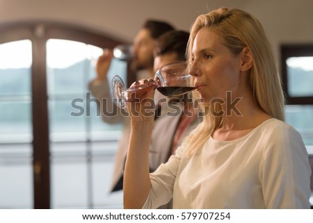 Wine tasting event with people degustating wines #579707254