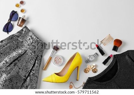 Flat lay set of female clothes and accessories on white background #579711562