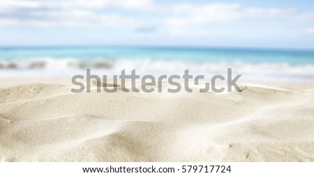 closeup of sand on beach and blue summer sky  #579717724