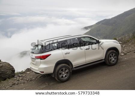 Sonla, Vietnam - Jan 21, 2017: Toyota Fortuner 2016 all new car on the mountain road in test drive, Vietnam. #579733348