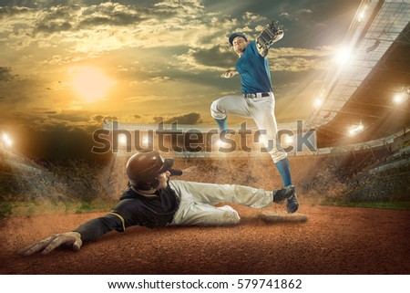 Baseball players in action on the stadium. #579741862